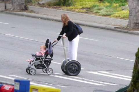 Woman on a ooo pushing her baby in a stroller